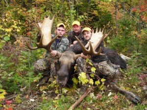 Hunters Posing with Trophy Moose